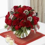 Reference #  B10-4962 Starting at $ 49.99 Rich red roses are a standout arranged amongst red carnations and mini carnations, red hypericum berries and an assortment of lush holiday greens.