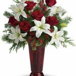 Reference # T117-1A  Starting at $ 72.95 An elegant Christmas arrangement of white asiatic lilies, red roses and Douglas fir, this fabulously fragrant gift lends seasonal sparkle to any room.\nWhite asiatic lilies, red roses, Douglas fir, seeded eucalyptus and small red berries .