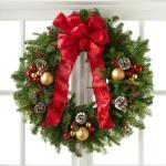 Reference # B9-5140 Starting at $85.99 With a base consisting of fresh and fragrant Christmas greens, this wreath is bedecked with white tipped pine cones, shining red and gold glass holiday balls, and clusters of berries, culminating in a standout red bow at the top.