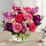 Reference # B20-4970 Starting at $ 49.99  Hot pink and pink roses are brought together with purple, lavender and fuchsia stock stems accented with pink Peruvian lilies and lush greens to create a simply stunning flower arrangement. Presented in a clear glass bubble bowl vase,