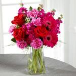 Reference # C21-5184 Starting at $ 54.99  The power of pink is packed into one beautifully blushing bouquet to make your recipient's day one they will never forget! Red roses make the hot pink petals of carnations, gilly flower, and gerbera daisies pop in this fun and fanciful flower arrangement .