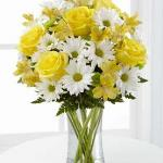 reference # C3-4793 Starting at $ 43.99 The Sunny Sentiments™ Bouquet by FTD® is a blooming expression of charming cheer. Brilliant yellow roses and Peruvian lilies share the spotlight with white traditional daisies and green button poms to create a memorable bouquet.
