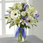 Reference # B19-5142 Starting at $ 44.99 Blue iris catch the eye arranged amongst a bed of snowy white flowers including roses, gerbera daisies, Asiatic Lilies, and Peruvian  Lilies.