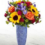 Reference # 18S1-D Starting at $ 54.99 Touch of Spring® Bouquet brings fresh beauty and color to your special recipient's door.! Bold sunflowers and orange roses take center stage of this fresh flower arrangement .  Starting at $ 54.99