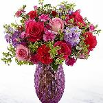 Reference #  18-S1 Starting at $49.99 Blossoming with unmatched color and texture, this fresh flower arrangement brings together pink roses, hot pink roses, purple gilly flower, hot pink carnations, violet mini carnations, and lush greens to create a gorgeous presentation.