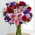 Reference  # C16-4839 Starting at $ 69.99  rich red roses, lavender carnations, red Peruvian lilies, purple double lisianthus, purple matsumoto asters and lush greens. Presented in a classic clear glass vase, this elegant bouquet is an incredible way to convey your sweetest sentiments.