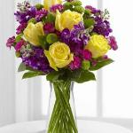 Reference  #  D3-4897 Starting at $ 47.99 he Happy Times™ Bouquet by FTD® employs roses and stock to bring vibrant color and fragrance straight to their door on their special day. Yellow roses, purple stock, green button poms, fuchsia mini carnations & lush greens create a stunning display. .