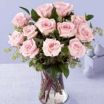 Reference #  E8-4304 Starting at 59.99 Picture-perfect soft pink roses make a beautiful gift for the lovely lady in your life. Wife, mother, daughter or sweetheart, she's sure to cherish this bouquet of pastel pink roses accented with seeded eucalyptus and arranged in a clear glass vase.