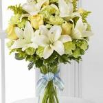 $Reference #  D7-4905D Starting at $39.95 Yellow roses and carnations are brought together with pale green mini carnations, white Asiatic lilies, yellow solidago and lush greens exquisitely arranged in a clear glass gathered square vase.
