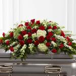 Reference # S16-4467  Casket Cover from $ 295.00  Sincerity™ Casket Spray is a wondrous presentation of fresh color and beauty. Rich red roses and carnations are eye-catching and elegant in an arrangement of white hydrangea, larkspur, snapdragons