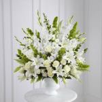 Reference # S2-4438 From $ 99.00 Morning Stars™ Arrangment is a brilliant expression of peace and soft serenity. White roses, carnations, gladiolus, stock and Oriental lilies are accented with the bright green stems of Bells of Ireland and a gorgeous assortment of lush greens