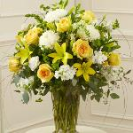 Reference # 91298 As shown $109.00  Features the freshest yellow roses, white football mums, stock, snapdragons and more