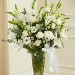 Reference # 91302 As shown $ 109.00 Send your most sincere condolences and beauty in times of sorrow with our elegant all-white sympathy arrangement. Features the freshest white roses, hybrid lilies, cremones.