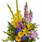 Reference # T218-2A As shown $ 125.00  This tapestry of colorful flowers includes blooms such as blue hydrangea, lavender roses, yellow asiatic lilies, yellow gerberas, yellow gladioli, yellow and lavender snapdragons, lavender daisies