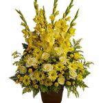 Reference # T219-1A As shown $ 149.00  Bright yellow blooms such as roses, gladioli, button mums, daisies and solidago, accented by leatherleaf fern.