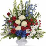 Reference # T240-1A As shown $ 139.00 A classic all-American display of patriotic red, white and blue flowers pays tribute to the memory of one who proudly served his country, and is a testament to hope, freedom and strength.