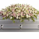 Reference #T236-3A As shown $ 425.00 A graceful and magnificent cascade of delicate pale pink, white, and crème flowers conveys everlasting affection for the radiant spirit being honored, and gently eases sorrow for those paying respect.